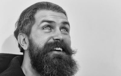 bearded man, long beard, brutal caucasian hipster with moustache on smiling happy face, unshaven guy getting haircut by hairdresser at barbershop look up on white background, copy space